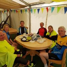Photo of the Cat 5 riders taking refreshments at Cammas Hall Fruit Farm